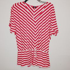 Red / White Striped Blouse Size medium. Red / white ; striped. Stretchy fit. Slightly longer style blouse. Poly / rayon. Faded Glory Tops Blouses
