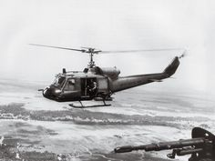 Two Bell UH-1Bs flown by the Navy's lone helicopter attack unit in Vietnam, The Seawolves, patrol the country's south on a 1967 mission to support Navy SEALs