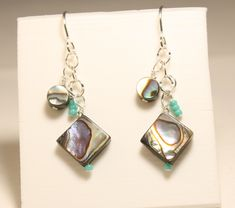 Take+a+trip+to+the+seashore+with+these+lovely+earrings!+I+have+both+round+and+diamond+shape+Abalone+shells+hanging+from+sterling+silver+chain.+I+have+accented+the+shells+with+turquoise+color+glass+beads.+  Ear+hooks+are+sterling+silver.+Earrings+hang+down+1.75+inches+from+top+of+hook.  Enjoy+...