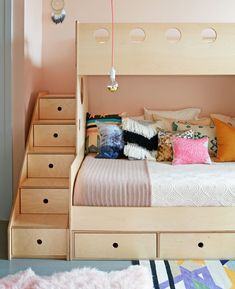Benjamin Moore's seashell-pink Odessa paint was used in the girls' bedroom. Benjamin Moore's seashell-pink Odessa paint was used in the girls' bedroom. The birch plywood bunk bed is by Brooklyn-based Casa Kids. Bunk Beds With Storage, Kids Bunk Beds, Toy Storage, Extra Storage, Family Room Design, Kids Room Design, Casa Kids, Modern Bunk Beds, Bed Frame Design