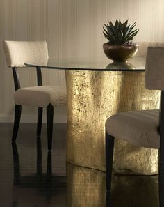 Philips Collection Tree trunk table Cast from real tree trunks and available in Gold and Silver Leaf, Bronze, Walnut, and White.