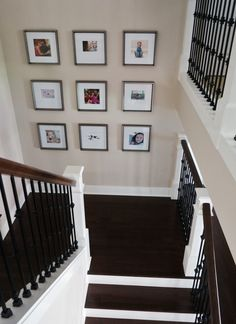 Metallic gray frames. Gallery wall on staircase landing.