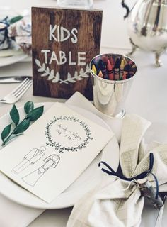 A personalized printable is an easy way to make the kids' table the fun table at the wedding reception!