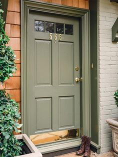 I chose an olive green color for the trim and front door to make the exterior more cohesive and compliment the architectural elements of the home-->http://hg.tv/y8na