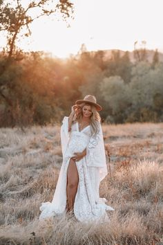 White lace reclamation traveling dress with a flat brim hat. White Lace Maternity Dress, Maternity Photo Outfits, Maternity Dresses For Photoshoot, Fall Maternity, Maternity Session, Bohemian Maternity Dress, Romantic Maternity Photos, Maternity Styles, Maternity Pictures