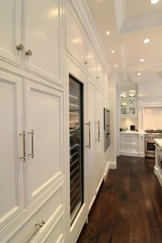 kitchen with dark wood floors but change the color of the cabinets to a darker color
