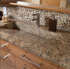 River stones bathroom backsplash
