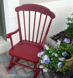 Old rocking chair with a fresh coat of deep red paint and a dark metallic glaze.  #painted furniture #Vintage Paints