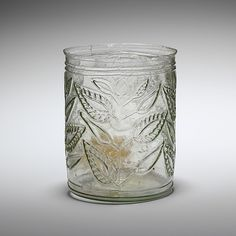 """""""A glass beaker with a delicate leaf and floral design, from the century AD. The beaker has been broken and repaired on one side of the rim and upper body but apart from that is complete. It is thought to come from Idalium, and is now in the Sunderland, Art Romain, Shot Glass, Glass Vase, Photo Images, 1st Century, British Museum, Earthenware, Art History"""