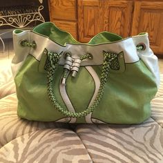 """Green handbag Great bag for summer. Nicole Lee green and white bag with braided handle and outside zip pocket on back. Inside has zip side pocket and two open side pockets. 7"""" drop on handle. EUC Nicole Lee Bags Shoulder Bags"""