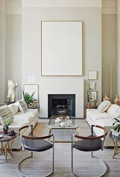 Modern White Living Room Design Featuring Pale Warm Griege Walls, Large  White Textured Wall Art, White Upholstered Sofas, And Modern Leather And  Metal Side ... Part 73
