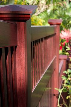 /illusionsfence/ V5701-5 Semi Privacy Grand Illusions Vinyl WoodBond fence with 6″ Wide Boards and Framed Victorian Top Pickets shown in Mahogany (W101). Chosen to match the mahogany trim and decking of this beautiful Hawaiian home. #fenceideas #dreamyard #fence