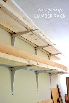 How I made this cheap and EASY DIY lumber storage rack in my garage workshop for FREE with my dad's old heavy-duty shelf brackets! It only took about an hour to paint and hang. Garage Workshop Organization, Diy Garage Storage, Garage Shelving, Shelves, Storage Ideas, Tool Storage, Storage Cart, Lumber Storage Rack, Lumber Rack