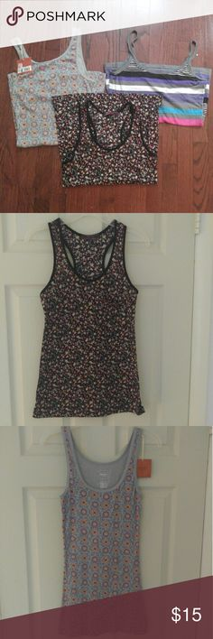Tank top bundle. Size LG/LG Jr. Black floral with small pocket in upper left corner, grey floral is NWT Mossimo & striped tank top is Op Mossimo Supply Co Tops Tank Tops