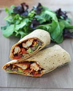 These Spicy Southwest Chicken Wraps with corn, black beans and avocado are quick, easy and SO DELICIOUS! Only 300 calories or 9 Weight Watchers SmartPoints! www.emilybites.com
