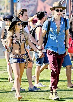 Queen of Coachella, Vanessa Hudgens, walks with boyfriend Austin Butler at the festival on Apr. 12