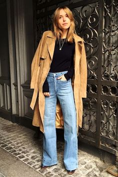 Photo via: Vogue Completely smitten with the way blogger Pernille Teisbaek effortlessly pairs a chic and classic suede trench coat with a black shirt and wide-leg jeans. Get the look: + Y.A.S Trish Su