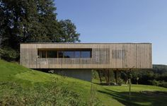 Poised over the edge of a hill in Hutten, Austria, Juri Troy Architects designed this residence to be both cost effective and passive. By lifting the home up over...
