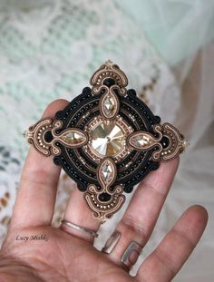 Check out this item in my Etsy shop https://www.etsy.com/ru/listing/518525193/gold-and-black-brooch-beaded-embroidered