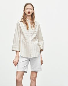 """New! Did you know you can now find out how every garment was made? Click the """"Who Made It"""" Tab. <br /><br /> An oversized tuxedo style shirt with a defined wide and cropped sleeve that adds an interesting design element to your style.  Constructed out o"""