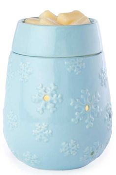 """SNOWFLAKE Illumination Fragrance Warmer by Candle WarmersThe SNOWFLAKE Illumination Fragrance Warmer by Candle Warmers is designed to warm scented oils and wax creating the glow and ambiance of a burning candle while releasing the fragrance. Each style brings a relaxing mood to the room and elegance to any home d�cor. Dimensions are : 7"""" tall x 5"""" wideUses NP5 replacement bulbs.120 v Power Plug in cord"""