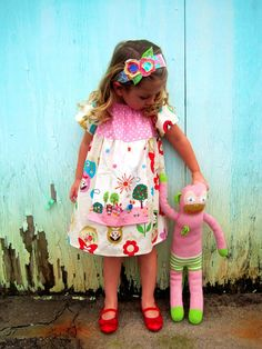 Pretty in PINK MATRYOSHKA DOLL - Peasant Apron Dress -- Available in Sizes 6m 12m 18m 2T 3T 4T 5 6 7 8. $48.00, via Etsy.