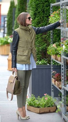 Olivia Palermo rocks her military jacket with leather sleeves while flower shopping!