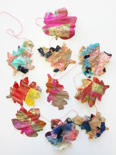 Making fall leaf garlands is a great art project idea you can do with your whole family. This is an easy tissue paper craft using glue that's lot of fun!