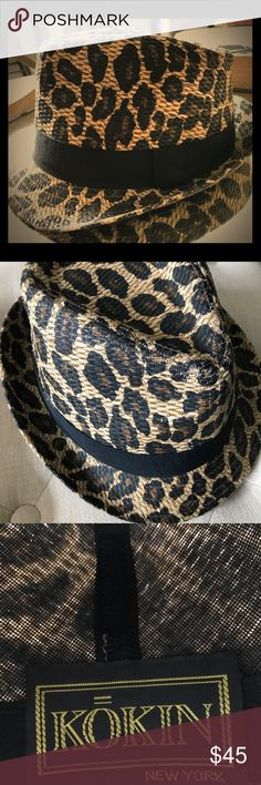 Leopard print raffia fedora This leopard print, raffia fedora is an adorable accent to any classic black outfit or black jeans and T. It has a black grosgrain ribbon band along the outside. kokin Accessories Hats