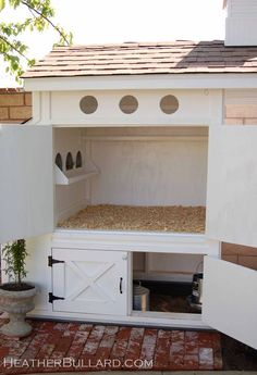 There's an idea! Keep the food+water UNDER the coop, with a cabinet [with latch] for access!
