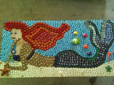 Cool table made by my mom, its bottle caps, river rock and scrap metal