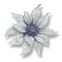 SAPPHIREᅠ ANDᅠ DIAMONDᅠ BROOCH,ᅠ CARTIER Ofᅠ floralᅠ design,ᅠ theᅠ centreᅠ setᅠ withᅠ circular-cutᅠ sapphires,ᅠ theᅠ petalsᅠ pavé-setᅠ withᅠ brilliant-cutᅠ diamonds,ᅠ mountedᅠ inᅠ platinum, signedᅠ Cartierᅠ andᅠ numbered,ᅠ Frenchᅠ assayᅠ andᅠ maker'sᅠ marks.