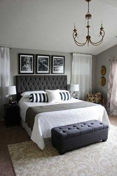 Darker gray master bedroom interior design.