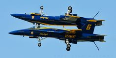 Navy F/A-18's from the Navy Blue Angels make a mirror image pass.