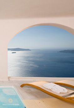 Dreamy volcano views from a private terrace at the Gold Suites in Santorini