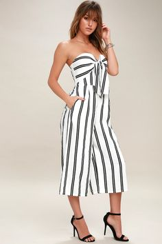 Lulus Exclusive! From brunch to the beach, the Margo Black and White Striped Strapless Midi Jumpsuit will take you there! Medium-weight, woven fabric sweeps over the strapless bodice with hidden V-bar and no-slip strips, while a front tie detail lays over padded cups. Midi-length, wide-cut pant legs have hidden side seam pockets. Elasticized back and hidden back zipper.