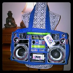 Audio Coture duffle bag by Parcel This bag is gently worn. Zipper works just that the pull piece is missing. I have a shoe string on it. Royal blue.  Looks like a boom box. Has wired that attach to phone or ipod and it plays on the built in speakers. Sooo totally rad. Original brand tag still attached.  Just a bit worn on top corners. This is from early 2000s.  I consider it new Millennium vintage.lol inside is perfect condition has 1 inside pocket that works. 19 inches across. 10 1/2 inches…