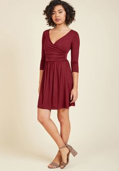 <p>Every place you visit draped in this flowy frock, countless compliments highlight its stunningly rich shade of navy. The wrapped V-neck bodice and ruched waist of this frock also receive honorable mentions, and that's why you love to take this darling dress out!</p>