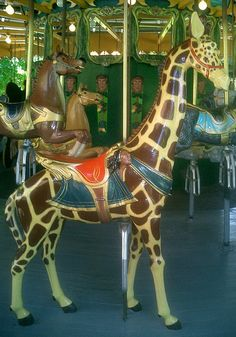 Tall giraffe on the 1907 carousel in Centreville, Toronto