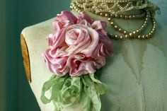 French rose corsage sewn out of silk-satin fabric.