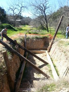 Eco building engineer instructors preparing this trench for a class on how to build an underground greenhouse (walapini) on March 5th