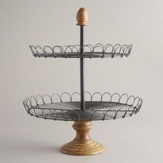 The unique design of our Edin Wood 2-Tiered Stand blends a metal top with a wooden base. Crafted in India, this piece is a perfect way to showcase anything from fruit, flowers or baked goods while hosting family and friends.