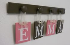 Nursery Decorations Wooden Letters Includes 4 Pegs and Custom Baby Name EMMA in Pink and Brown. Personalized for Girls Room. $21.00, via Etsy.