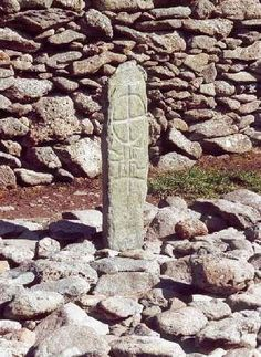 """Ogham Stone. Ogham is an Early Medieval alphabet used primarily to write the Old Irish language, and the Brythonic language.[3] Ogham is sometimes called the """"Celtic Tree Alphabet"""", based on a high medieval Bríatharogam tradition ascribing names of trees to the individual letters. There are roughly 400 surviving ogham inscriptions on stone monuments throughout Ireland and western Britain; the bulk of them are in the south of Ireland, in Counties Kerry, Cork and Waterford."""