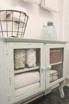Bathroom storage -- if there's room, a small dresser/bureau would be perfect for storing extra towels and sundries