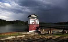 In this Tuesday, July 19, 2016 photo, the tower at Lake Lanier Olympic Park, home of the 1996 Summer Olympic Games rowing events, stands after being renovate...