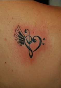 Clef heart with piano wing by WolfenXIII.deviantart.com on @deviantART