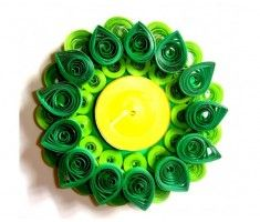 Hand crafted beautiful tea light or candle holder inspired from the art of paper quilling on makenlive.com   #paperquilling #art #candle #tealightholder #light