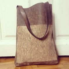 Brown leather totebag with dotted pocket by ihay