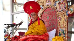 His Holiness the Dalai Lama wearing a traditional Drikung Kagyu hat during  the teachings in Bodh 7f4a8431cce2